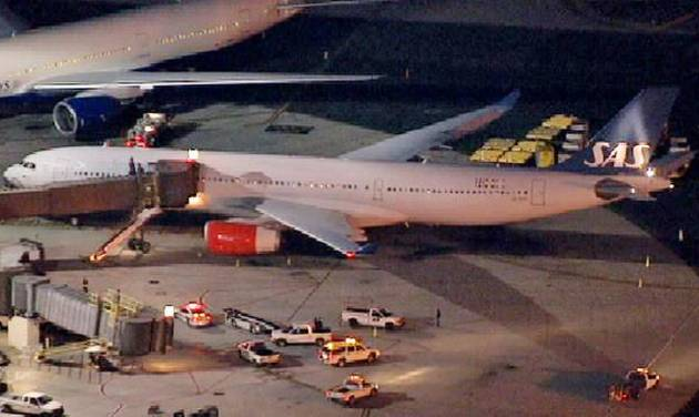 In this image taken from video and provided by television station WNBC-TV, a damaged SAS Airbus A330 sits on the tarmac at Newark Liberty International Airport after clipping the wing of another aircraft on takeoff, Wednesday, May 1, 2013 in Newark, N.J. Federal Aviation Administration officials say no one was injured in the incident at about 7:30 p.m. (AP Photo/WNBC-TV) MANDATORY CREDIT