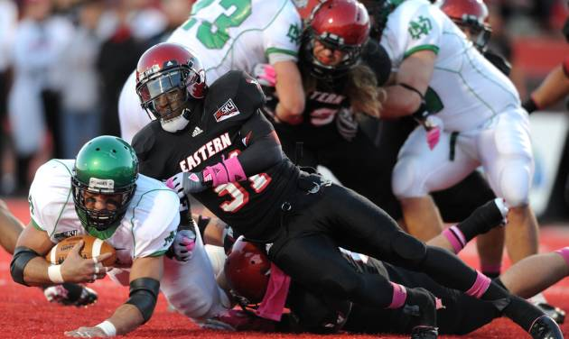 Eastern Washington's T.J. Lee III (31) brings down North Dakota's Mitch Sutton, left, during the first half of a Big Sky Conference NCAA college football game on Saturday, Oct. 6, 2012, at Roos Field in Cheney, Wash. (AP Photo/The Spokesman-Review, Tyler Tjomsland)