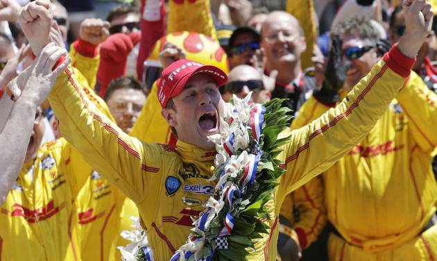 Ryan Hunter-Reay celebrates winning the 98th running of the Indianapolis 500 IndyCar auto race at the Indianapolis Motor Speedway in Indianapolis, Sunday, May 25, 2014. (AP Photo/AJ Mast)