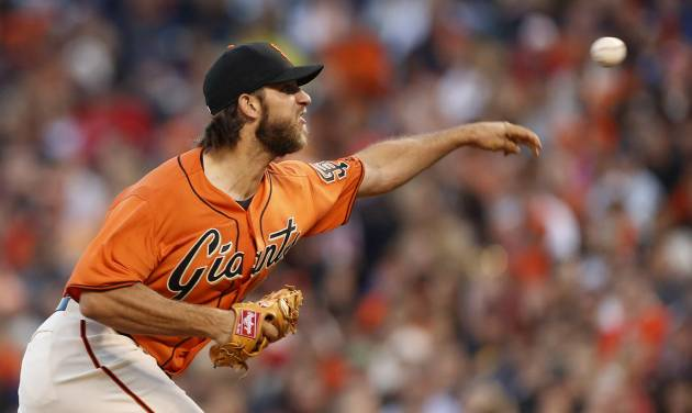 San Francisco Giants pitcher Madison Bumgarner releases the ball during the third inning of a baseball game against the Philadelphia Phillies, Friday, Aug. 15, 2014, in San Francisco. (AP Photo/Beck Diefenbach)