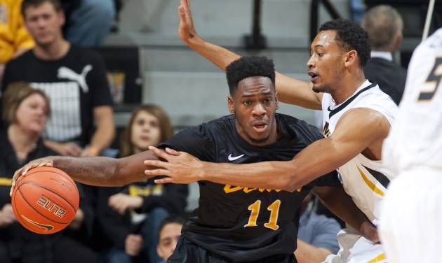 Long Beach State's David Samuels, left, pushes past Missouri's Johnathan Williams III, right, as he drives to the basket during the first half of an NCAA college basketball game Saturday, Jan. 4, 2014, in Columbia, Mo. (AP Photo/L.G. Patterson)