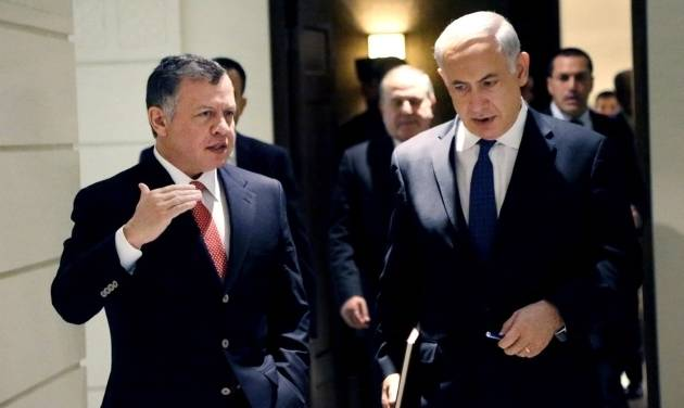 In this photo released by the Jordanian Royal Palace, Israeli Prime Minister Benjamin Netanyahu, right, listens to Jordan's King Abdullah II, left, as thy meet at the Royal Palace in Amman, Jordan, Thursday, Jan. 16, 2014. (AP Photo/Yousef Allan, Jordanian Royal Palace)