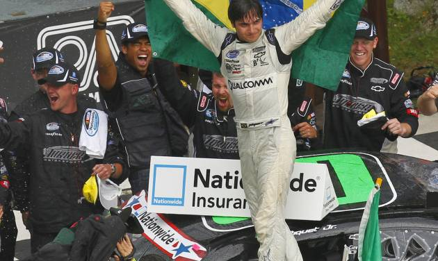Nelson Piquet Jr. celebrates in victory lane after winning the NASCAR Nationwide Series Sargento 200 auto race at Road America in Elkhart Lake, Wis, Saturday, June, 23, 2012. (AP Photo/Jeffrey Phelps)