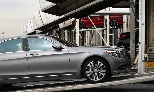 In this March 27, 2014 photo, a Mercedes-Benz sedan rolls onto a car-carrier at the company's Vehicle Processing Center in Baltimore. The Commerce Department issues its April report on wholesale stockpiles on Tuesday, June 10, 2014. (AP Photo/Patrick Semansky)