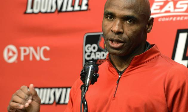 Louisville head football coach Charlie Strong speaks with reporters Thursday, Dec. 6, 2012, in Louisville, Ky. Strong announced this morning that he has turned down the head coaching job offer from the University of Tennessee and will stay at Louisville. (AP Photo/Timothy D. Easley)
