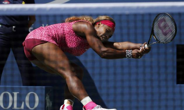 Serena Williams, of the United States, follows through as she returns a shot during the second round of the 2014 U.S. Open tennis tournament, Thursday, Aug. 28, 2014, in New York. (AP Photo/Elise Amendola)