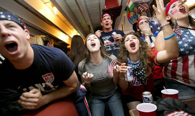 CORRECTS SPELLING OF BAR TO ROGUE, NOT ROUGE - From left, Chris Lathouwers, Sophia Raffetto, and Cimone Trout react to a missed USA scoring chance while watching the last minute of the the World Cup game against Germany at the Gone Rogue bar on Thursday, June 26, 2014 in Boise, Idaho. Germany defeated USA 1-0. (AP Photo/The Idaho Statesman, Kyle Green)  LOCAL TELEVISION OUT