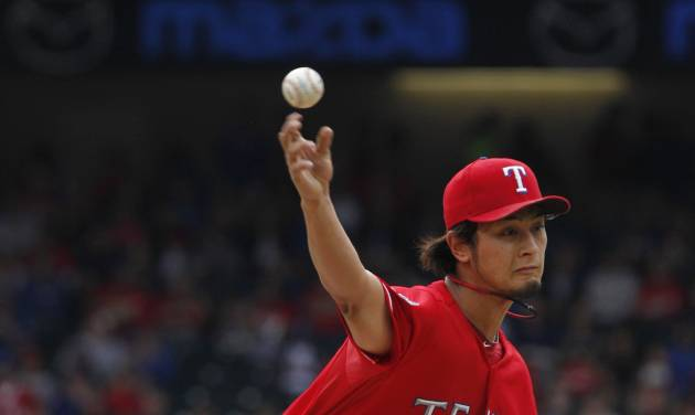 Texas Rangers starting pitcher Yu Darvish (11) of Japan throws against the Los Angeles Angels during the first inning of game one of a baseball double header Sunday, Sept. 30, 2012, in Arlington, Texas. (AP Photo/LM Otero)