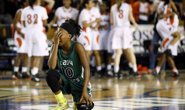 Edmond Santa Fe's Cameerah Graves (10) reacts after Santa Fe lost to Booker T. Washington in a Class 6A girls high school basketball game in the semifinals of the state tournament at the Mabee Center in Tulsa, Okla., Friday, March 8, 2013. Bookter T. Washington won, 72-70. Photo by Nate Billings, The Oklahoman