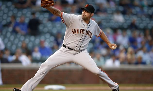 San Francisco Giants relief pitcher Jeremy Affeldt delivers against the Chicago Cubs during the eighth inning of the continuation of a rain-suspended baseball game that began Tuesday, on Thursday, Aug. 21, 2014, in Chicago. (AP Photo/Andrew A. Nelles)