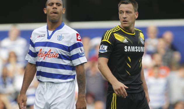 Queens Park Rangers' Anton Ferdinand, left, is marked by Chelsea's John Terry as Chelsea defend a corner during their English Premier League soccer match at Loftus Road stadium, London, Saturday, Sept. 15, 2012. (AP Photo/Sang Tan)