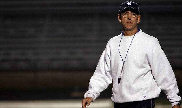 El Reno High School football coach Tom Cobble watches as the El Reno football team practices at Yukon High School on Tuesday, Nov. 25, 2008, in Yukon, Okla. El Reno was getting some practice time on the artificial turf before playing this week's semifinal playoff game at Mustang High School.   STAFF PHOTO BY CHRIS LANDSBERGER  ORG XMIT: KOD