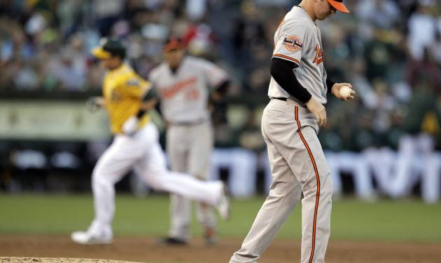Baltimore Orioles' Zach Britton, right, turns his back as Oakland Athletics' Stephen Drew rounds the bases after Drew hit a home run off Britton in the third inning of a baseball game Saturday, Sept. 15, 2012, in Oakland, Calif. (AP Photo/Ben Margot)