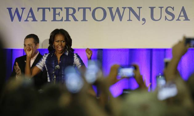 First Lady Michelle Obama participates in an event at Watertown High School to encourage people to drink more water, Thursday, Sept. 12, 2013, in Watertown, Wis. (AP Photo/Morry Gash)