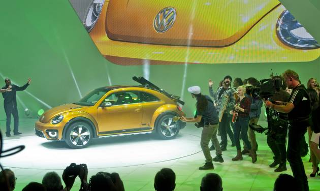 The Volkswagen Beetle Dune concept car is unveiled with performers, Monday, Jan. 13, 2014, at the North American International Auto Show in Detroit, Mich. (AP Photo/Tony Ding)