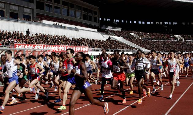 FILE - In this April 14, 2013 file photo, runners compete at the start of the 26th Mangyongdae Prize Marathon at Pyongyang's Kim Il Sung Stadium as North Korea hosts the sports event to mark the birthday of the late leader Kim Il Sung on April 15. For the first time ever, North Korea is opening up the streets of its capital to runner-tourists for the annual Pyongyang marathon, undoubtedly one of the most exotic feathers in any runner's cap. Tourism companies say they have been inundated by requests to sign up for the April 13, 2014 event, which this year will include amateur runners from around the world. (AP Photo/Jon Chol Jin, File)