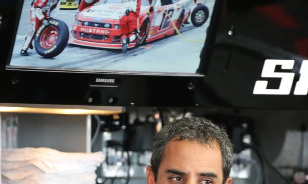 Driver Juan Pablo Montoya is seen in the garage before a practice session for the NASCAR Sprint Cup series Quicken Loans 400 auto race at Michigan International Speedway in Brooklyn, Mich., Friday, June 13, 2014. Montoya will compete in his first NASCAR race of the season, a tuneup for next month's Brickyard 400. (AP Photo/Bob Brodbeck)