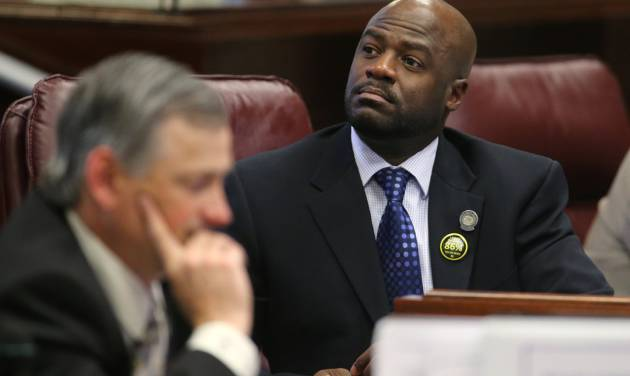 Nevada Sen. Kelvin Atkinson, D-North Las Vegas, listens to debate on the Senate floor at the Legislative Building in Carson City, Nev., on Wednesday, May 22, 2013. The Senate approved Atkinson's bill which will lead to closing the state's coal-fired plants and pave the way for the state's biggest electrical utility to transition to more renewable sources. At left is Sen. James Settelmeyer, R-Minden. (AP Photo/Cathleen Allison)