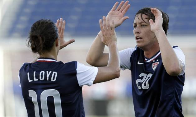 United State's Abby Wambach (20) high-fives teammate Carli Lloyd (10) after Wambach scored against Russia during an international friendly soccer match in Boca Raton, Fla., Saturday, Feb. 8, 2014. The U.S. won 7-0. (AP Photo/Alan Diaz)