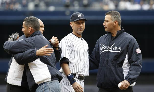 From left, former New York Yankees relief pitcher Mariano Rivera, former Yankees catcher Jorge Posada, New York Yankees shortstop Derek Jeter and former New York Yankees starting pitcher Andy Pettitte embrace after Rivera and Pettitte threw out the ceremonial first pitches to Posada and Jeter before the Yankees home opening baseball game against the Baltimore Orioles, at Yankee Stadium in New York, Monday, April 7, 2014.  (AP Photo/Kathy Willens)