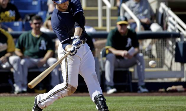 Milwaukee Brewers' Ryan Braun hits a home run during the eighth inning of an exhibition baseball game against the Oakland Athletics Wednesday, March 5, 2014, in Phoenix. (AP Photo/Morry Gash)