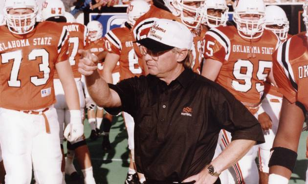 """COLLEGE FOOTBALL: """"OSU coach Pat Jones leads the linemen onto the field for pre-game drill"""" as the Oklahoma State University Cowboys hosted the Tulsa Hurricane.  OSU prevailed, 24-19. Staff photo by Doug Hoke taken 9/26/92; photo ran in the 9/27/92 Daily Oklahoman."""