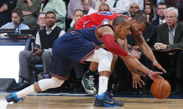 Denver Nuggets guard Randy Foye, front, pursues a loose ball with Los Angeles Clippers guard Willie Green in the first quarter of an NBA basketball game in Denver on Monday, March 17, 2014. (AP Photo/David Zalubowski)
