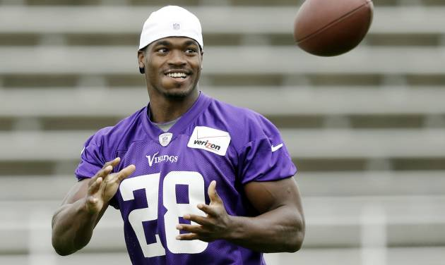 Minnesota Vikings running back Adrian Peterson catches the ball during NFL football training camp, Friday, July 26, 2013, in Mankato, Minn. (AP Photo/Charlie Neibergall)