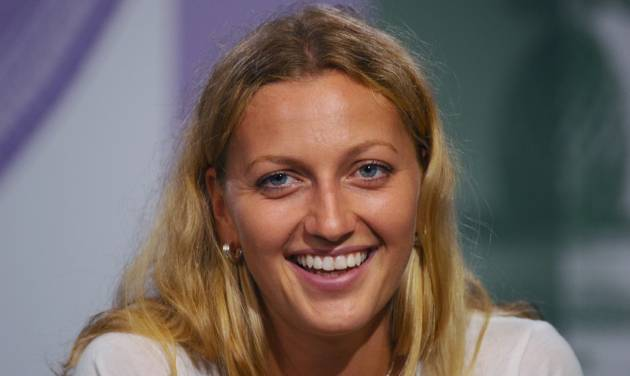 Petra Kvitova of Czech Republic attends a press conference after winning the 2014 women's singles final against Eugenie Bouchard of Canada at the All England Lawn Tennis Championships in Wimbledon, London, Saturday, July 5, 2014. (AP Photo/AELTC, Javier Garcia)