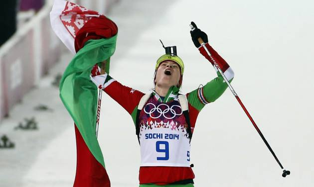 Belarus' Darya Domracheva celebrates after winning the gold medal in the women's biathlon 10k pursuit, at the 2014 Winter Olympics, Tuesday, Feb. 11, 2014, in Krasnaya Polyana, Russia. (AP Photo/Felipe Dana)