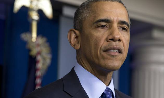President Barack Obama speaks about the situation in Iraq, Thursday, June 19, 2014, in the Brady Press Briefing Room of the White House in Washington. Obama said the US will send up to 300 military advisers to Iraq, set up joint operation centers.  (AP Photo/Jacquelyn Martin)