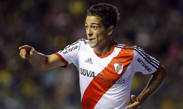 River Plate's Manuel Lanzini celebrates after scoring against Boca Juniors during an Argentine league soccer match in Buenos Aires, Argentina, Sunday, March 30, 2014. (AP Photo/Victor R. Caivano)