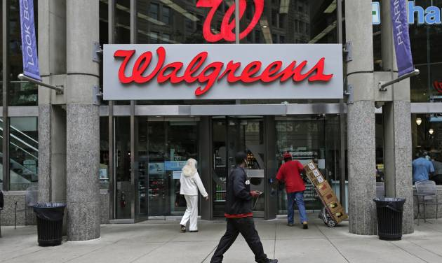 "This June 4, 2014 photo shows a Walgreens retail store in Boston. Walgreen Co. _ which bills itself as ""America's premier pharmacy"" _  is among many companies considering combining operations with foreign businesses to trim their tax bills. These deals, called inversions, have raised concerns among some U.S. lawmakers over the potential for lost tax revenue. (AP Photo/Charles Krupa)"