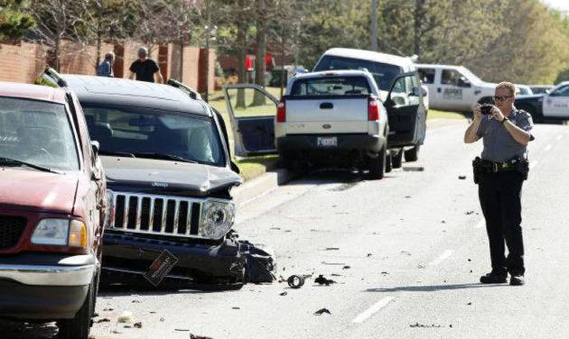 WRECK: Oklahoma City Police investigate a four-car injury accident at the intersection of NW 122 and Meridian in Oklahoma City, OK, Friday, April 1, 2011. By Paul Hellstern, The Oklahoman ORG XMIT: KOD