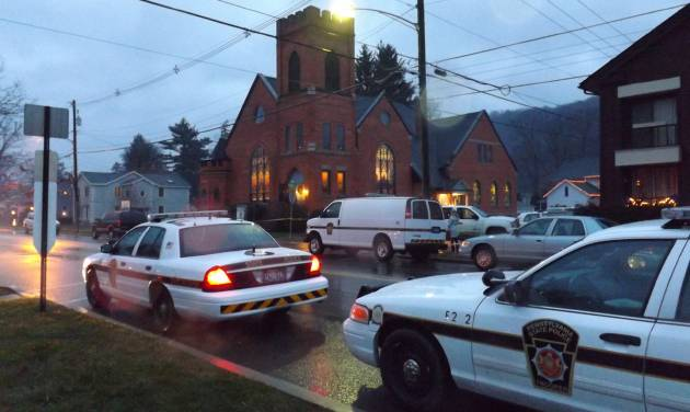 Police cars are parked at the 180-year-old First United  Presbyterian Church of Coudersport Sunday morning, Dec. 2, 2012, where church organist Darlene Sitler, 53, was shot  to death by her ex-husband Gregory Eldred, 52, during a worship service.  Eldred, an elementary school music teacher, walked into the church in the middle of Sunday services and shot and killed his ex-wife as she sat in a pew, police said. (AP Photo/The Bradford Era, Amanda Jones)