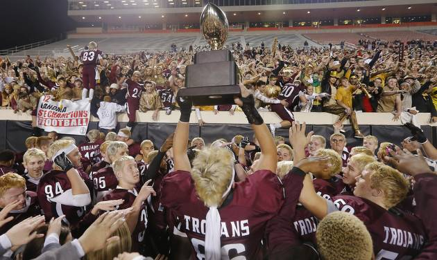 CLASS 6A HIGH SCHOOL FOOTBALL STATE CHAMPIONSHIP GAME: Jenks' Austin Martin (86) hoist the trophy for the Trojan fans during the Class 6A Oklahoma state championship football game between Norman North High School and Jenks High School at Boone Pickens Stadium on Friday, Nov. 30, 2012, in Stillwater, Okla.   Photo by Chris Landsberger, The Oklahoman