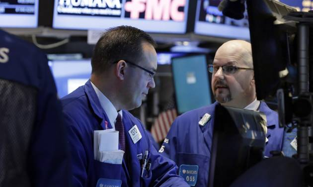 In this Wednesday, March 12, 2014, photo, specialists Anthony Matesic, left, and John Urrbanowitz confer as they work on the floor of the New York Stock Exchange. Asian stocks advanced Tuesday, March 18, 2014, on stronger U.S. factory production and relief that sanctions imposed on Russia following the Crimea reference avoid its vital economic interests. European markets were down. (AP Photo/Richard Drew)