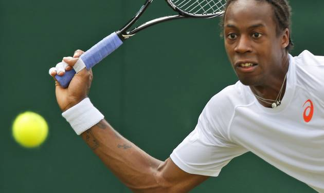 Gael Monfils of France returns to Jiri Vesely of the Czech Republic during their men's singles match at the All England Lawn Tennis Championships in Wimbledon, London, Thursday, June 26, 2014. (AP Photo/Sang Tan)