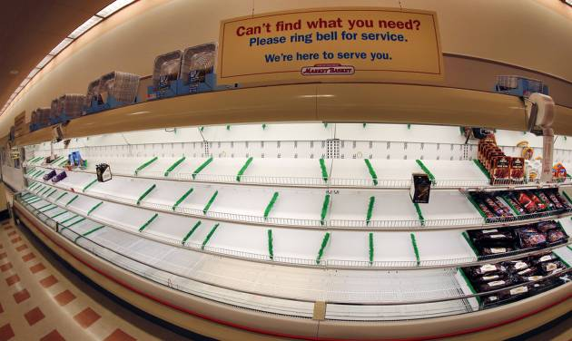 This photo made with a fisheye lens shows a sign atop mostly empty meat shelves at Market Basket in Haverhill, Mass., Monday, Aug. 18, 2014. As an employee revolt at the New England grocery store chain headed into its fifth week, the governors of Massachusetts and New Hampshire made the unusual move of personally stepping into negotiations aimed at ending a standoff threatening the future of the popular low-priced supermarkets. (AP Photo/Elise Amendola)