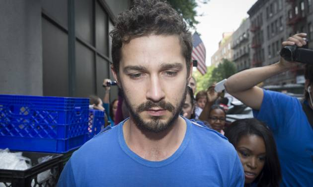 """Actor Shia LaBeouf is followed by media after leaving Midtown Community Court following his arrest the previous day for yelling obscenities at the Broadway show """"Cabaret,"""" Friday, June 27, 2014, in New York. The 28-year-old star of the """"Transformers"""" franchise faces charges that include disorderly conduct and criminal trespass.  (AP Photo/John Minchillo)"""