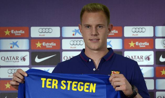 Marc-Andre Ter Stegen, from Germany, holds his new shirt during his official presentation as new goalkeeper of FC Barcelona at the camp nou stadium in Barcelona, Spain, Thursday, May 22, 2014. (AP Photo/Manu Fernandez)