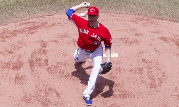 Toronto Blue Jays starting pitcher Drew Hutchinson works against the Milwaukee Brewers during first inning interleague baseball action in Toronto on Tuesday July 1 , 2014. (AP Photo/The Canadian Press, Chris Young)