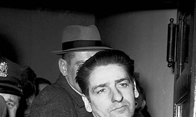 FILE - In this Feb. 25, 1967 file photo self-confessed Boston Strangler Albert DeSalvo is seen minutes after his capture in Boston. Authorities say DNA tests on the remains of DeSalvo confirm he killed Mary Sullivan, the woman believed to be the serial killer's last victim. DeSalvo admitted to killing Sullivan and 10 other women in the Boston area between 1962 and 1964 but later recanted. He was later killed in prison. (AP Photo, File)