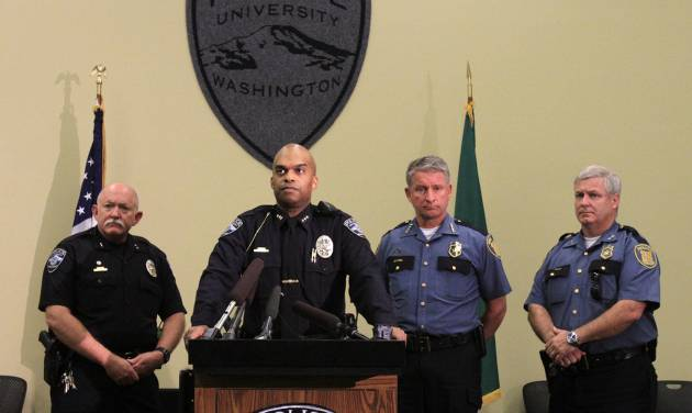 UW Police Chief John Vinson, at podium, discusses the stop of a truck containing molotov-cocktail like incendiary devices and the on-going investigation and stolen guns, Thursday, July 4, 2013. Left is UW Deputy Police Chief Randy West, then Vinson, SPD Chief Jim Pugel and then Assistant Chief Paul McDonagh (AP Photo/The Seattle Times, Alan Berner) OUTS: SEATTLE OUT, USA TODAY OUT, MAGAZINES OUT, TELEVISION OUT, SALES OUT. MANDATORY CREDIT TO: ALAN BERNER/THE SEATTLE TIMES