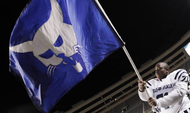 Star Spencer's Marquise Vardiman (71) waves the flag of the Bobcats after the Class 4A high school football state championship game between Star Spencer and Douglass at Boone Pickens Stadium in Stillwater, Okla., Saturday, December 5, 2009. Star Spencer won, 34-21. Photo by Nate Billings, The Oklahoman ORG XMIT: KOD
