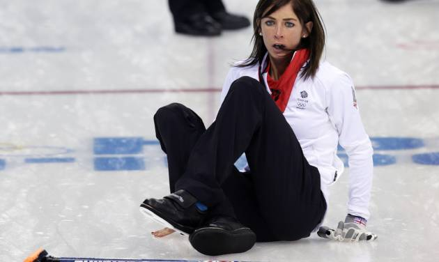 Great Britain's skip Eve Muirhead slips on the ice while shouting instruction after delivering the rock during women's curling competition against Russia at the 2014 Winter Olympics, Monday, Feb. 17, 2014, in Sochi, Russia. (AP Photo/Robert F. Bukaty)