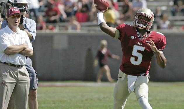 Floida State head coach Jimbo Fisher, left, watches as quarterback Jameis Winston attempts a pass in the first half of  an NCAA college spring football game on Saturday, April 12, 2014, in Tallahassee, Fla. (AP Photo/Steve Cannon)