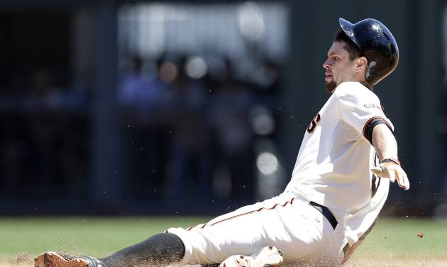 San Francisco Giants' Brandon Belt slides into second base with a double against the Miami Marlins during the fourth inning of a baseball game on Saturday, June 22, 2013, in San Francisco. (AP Photo/Marcio Jose Sanchez)