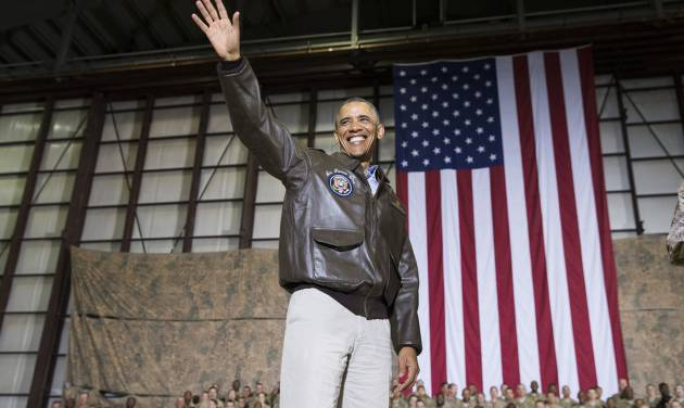 President Barack Obama waves as he arrives for a troop rally after arriving at Bagram Air Field for an unannounced visit, on Sunday, May 25, 2014, north of Kabul, Afghanistan. (AP Photo/ Evan Vucci)
