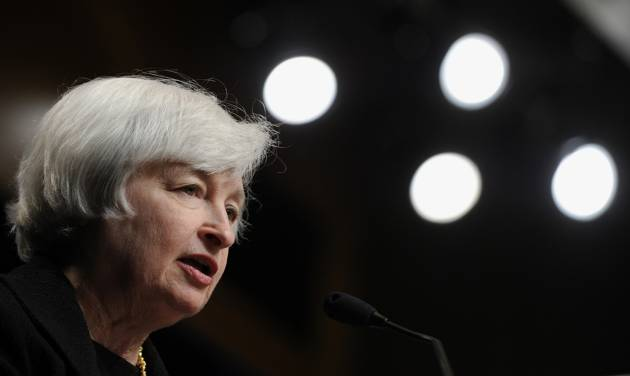 Federal Reserve Chair Janet Yellen speaks at the International Monetary Fund in Washington, Wednesday, July 2, 2014.  Yellen said she doesn't see a need for the Fed to start raising interest rates to address the risk that extremely low rates could destabilize the financial system.  (AP Photo/Susan Walsh)
